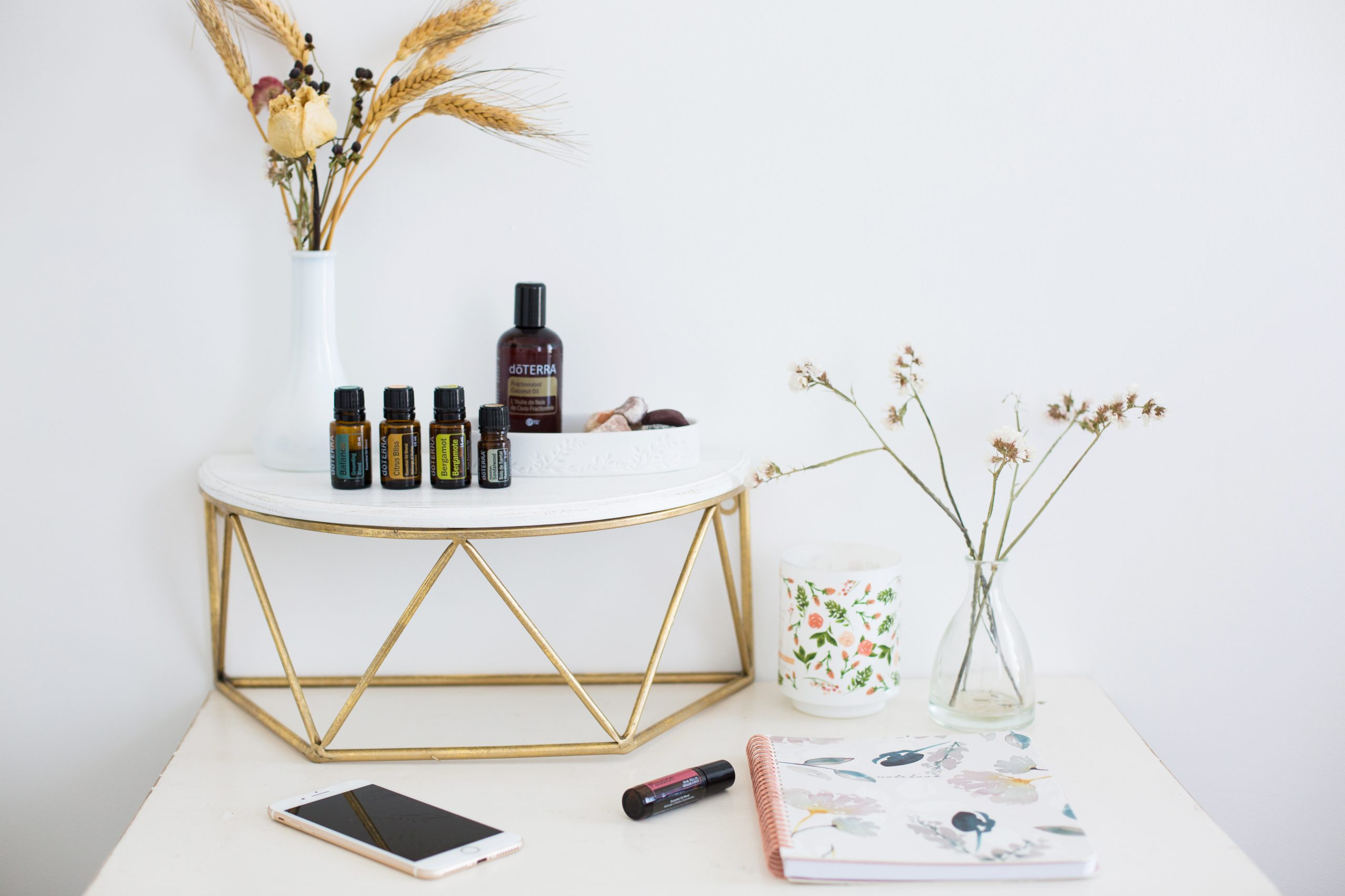 Table with essential oils, notebook and phone